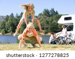 Small photo of Children playing leapfrog in countryside on motor home vacation