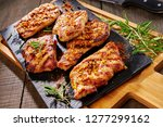 marinated juicy pork medallions ... | Shutterstock . vector #1277299162