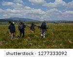 group of birdwatchers leaving a ... | Shutterstock . vector #1277333092