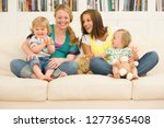 two pregnant mothers on sofa at ... | Shutterstock . vector #1277365408