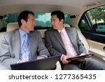 businessmen sitting in backseat ... | Shutterstock . vector #1277365435