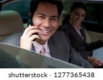 businessman in backseat of car... | Shutterstock . vector #1277365438