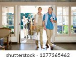 couple arriving in hotel foyer... | Shutterstock . vector #1277365462