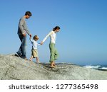 family on vacation walking on... | Shutterstock . vector #1277365498