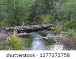 old small bridge through a... | Shutterstock . vector #1277372758