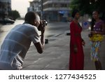young photographer standing... | Shutterstock . vector #1277434525