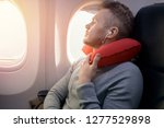 male passenger of airplane... | Shutterstock . vector #1277529898