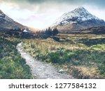 fresh snow covered peaks of... | Shutterstock . vector #1277584132