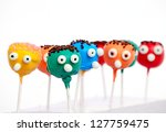 six cake pops with funny faces...   Shutterstock . vector #127759475