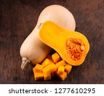 butternut squash over old wood... | Shutterstock . vector #1277610295