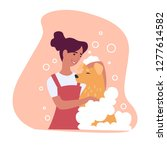 woman washing fur of... | Shutterstock .eps vector #1277614582