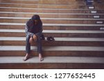 homelessness sits on the... | Shutterstock . vector #1277652445