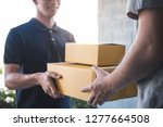 delivery mail man giving parcel ... | Shutterstock . vector #1277664508