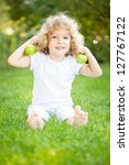 happy child playing with apples ... | Shutterstock . vector #127767122