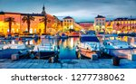 colorful evening cityscape of... | Shutterstock . vector #1277738062