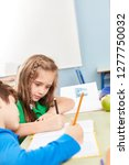 two students in class together... | Shutterstock . vector #1277750032