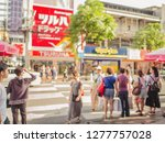 abstract blur photo of Unacquainted people walking in siam square at bangkok city thailand.Siam square road is very famous for Teenager in bangkok city