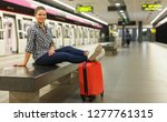 nice girl traveler waiting for... | Shutterstock . vector #1277761315