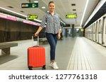 young woman traveler walking in ... | Shutterstock . vector #1277761318