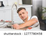 smiling adult repairman with... | Shutterstock . vector #1277780458