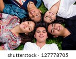happy smiling group of young...   Shutterstock . vector #127778705