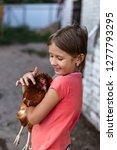 little rural girl with chicken... | Shutterstock . vector #1277793295