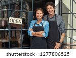 two cheerful small business... | Shutterstock . vector #1277806525