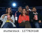 young people watching movie in... | Shutterstock . vector #1277824168