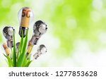 light bulb with banknotes and... | Shutterstock . vector #1277853628