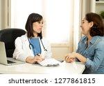 female family doctor listening... | Shutterstock . vector #1277861815