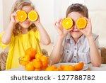 Children With Oranges. Happy...