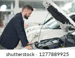 male client of car center...   Shutterstock . vector #1277889925