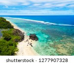 an aerial view of black rock... | Shutterstock . vector #1277907328