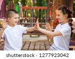 happy lovely children sitting... | Shutterstock . vector #1277923042