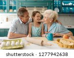 grandparents hug their lovely... | Shutterstock . vector #1277942638