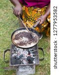 woman roasting coffee in a... | Shutterstock . vector #1277953582