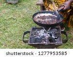 woman roasting coffee in a... | Shutterstock . vector #1277953585