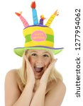 cheerful blond girl celebrates... | Shutterstock . vector #1277954062