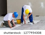 bricklayer at work in building... | Shutterstock . vector #1277954308