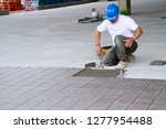 bricklayer at work in building... | Shutterstock . vector #1277954488