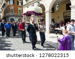 """Small photo of CORFU, GREECE - APRIL 6, 2018: The epitaph processions of Good Friday in Corfu. Every church is organizing a litany, carrying its """"Epitaphios"""" with the accompaniment of philharmonics."""