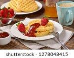 waffles and jam on breakfast... | Shutterstock . vector #1278048415