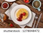 waffles and jam on breakfast... | Shutterstock . vector #1278048472