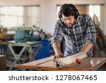 carpenter wearing safety gear... | Shutterstock . vector #1278067465
