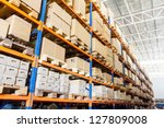 rows of shelves with boxes in... | Shutterstock . vector #127809008