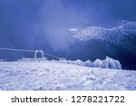 Landscape of snow mountains, lift and fence in 3-5 Pigadia, Naoussa, Greece.