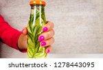 woman offer bottle of fruit... | Shutterstock . vector #1278443095