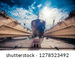 large cargo ship in dry dock... | Shutterstock . vector #1278523492
