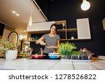 smiling woman cooking a healthy ... | Shutterstock . vector #1278526822