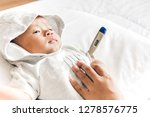 mother holding thermometer of... | Shutterstock . vector #1278576775